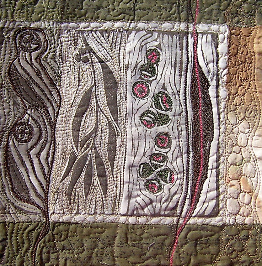 Thread painting and quilting over linocut